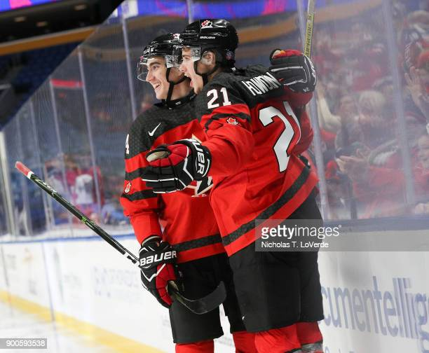 Brett Howden of Canada celebrates his goal with Alex Formenton of Canada during the first period of play in the Quarterfinal IIHF World Junior...