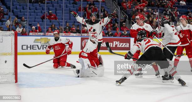 Brett Howden of Canada scores a goal past Emil Gransoe of Denmark to give Cananda a 20 lead during the first period of play in the IIHF World Junior...