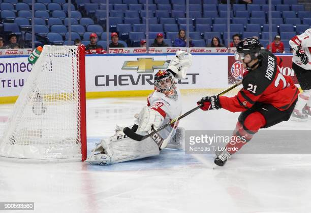 Brett Howden of Canada scores past Philip Wüthrich of Switzerland for team Canada's first goal during the first period of play in the Quarterfinal...
