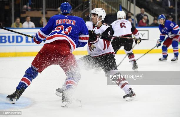 Brett Howden of the New York Rangers and Clayton Keller of the Arizona Coyotes cut the ice during their game at Madison Square Garden on October 22...