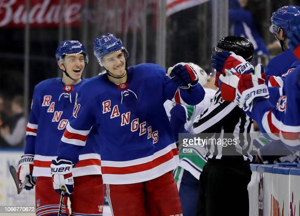 Brett Howden of the New York Rangers celebrates his game winning goal with teammates on the bench in the third period against the Vancouver Canucks...