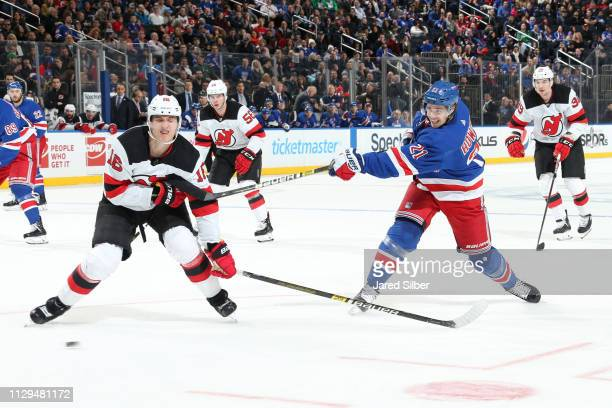 Brett Howden of the New York Rangers shoots the puck against Steven Santini of the New Jersey Devils at Madison Square Garden on March 9, 2019 in New...