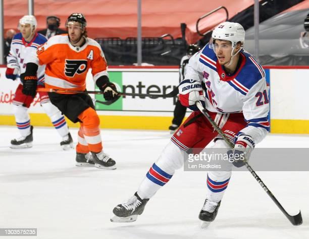 Brett Howden of the New York Rangers skates against Kevin Hayes of the Philadelphia Flyers at the Wells Fargo Center on February 18, 2021 in...