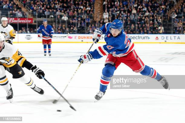 Brett Howden of the New York Rangers skates with the puck against the Pittsburgh Penguins at Madison Square Garden on November 12, 2019 in New York...
