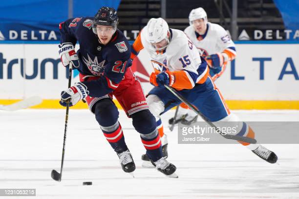 Brett Howden of the New York Rangers skates with the puck against the New York Islanders at Madison Square Garden on February 8, 2021 in New York...