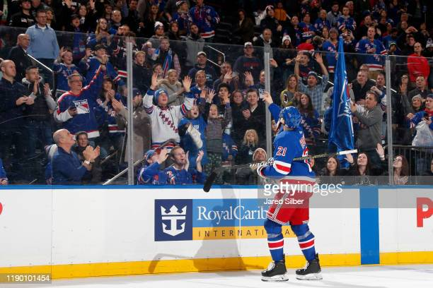 Brett Howden of the New York Rangers tosses a puck into the crowd after being named the third star of the game in a 5-1 win against the Anaheim Ducks...