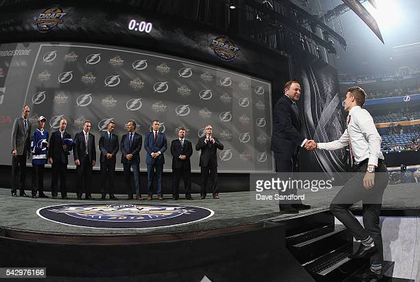 Brett Howden shakes hands with NHL commissioner Gary Bettman after being selected 27th overall by the Tampa Bay Lightning during round one of the...