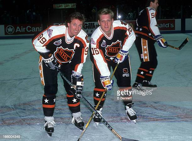 Brett Hull of the Campbell Conference and the St. Louis Blues and Wayne Gretzky of the Los Angeles Kings pose for a portrait before the 1993 44th NHL...
