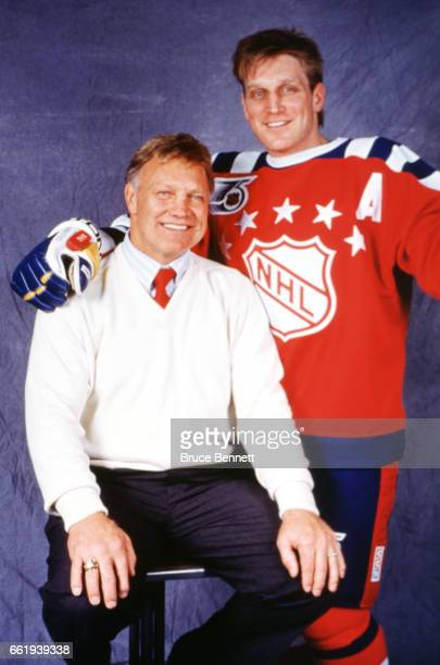 Brett Hull of the Campbell Conference and the St. Louis Blues poses for a portrait with his dad Bobby Hull before the 1992 43rd NHL All-Star Game...