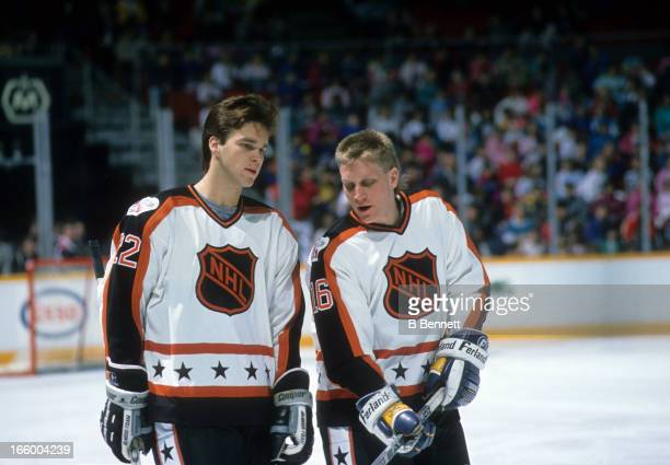 Brett Hull of the Campbell Conference and the St. Louis Blues talks with teammate Luc Robitaille of the Los Angeles Kings during the 1989 40th NHL...