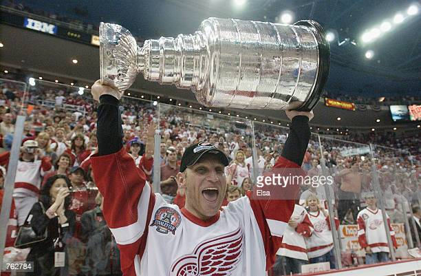 Brett Hull of the Detroit Red Wings celebrates with the Stanley Cup after defeating the Carolina Hurricanes in game 5 of the 2002 Stanley Cup Finals...