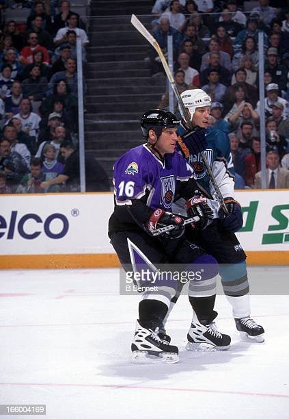 Brett Hull of the Western Conference and St. Louis Blues battles with Dino Ciccarelli of the Eastern Conference and Florida Panthers during the 1997...