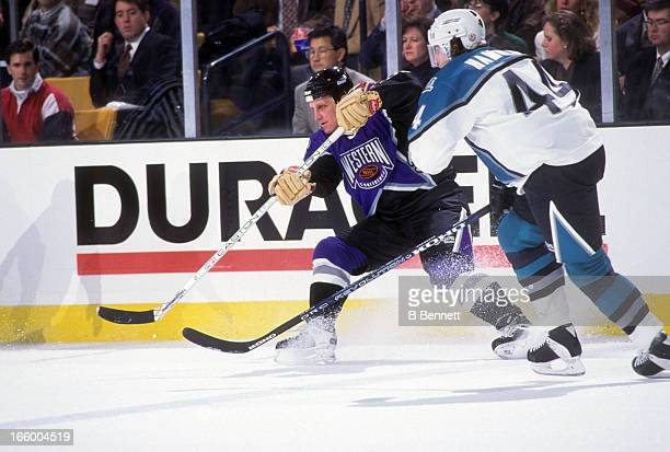 Brett Hull of the Western Conference and the St. Louis Blues is defended by Roman Hamrlik of the Eastern Conference and the Tampa Bay Lightning...