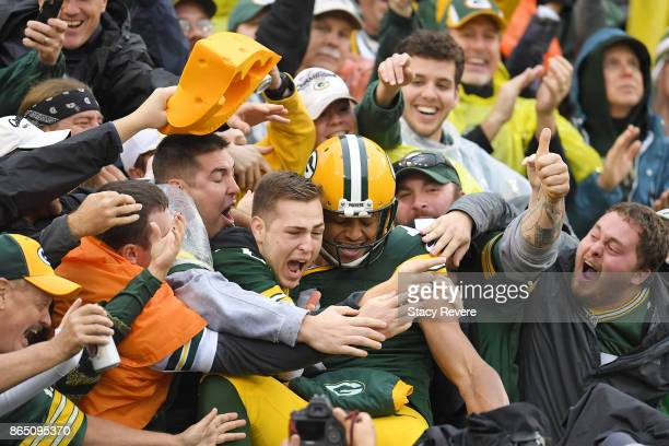 Brett Hundley of the Green Bay Packers celebrates a touchdown with fans during the second quarter against the New Orleans Saints at Lambeau Field on...