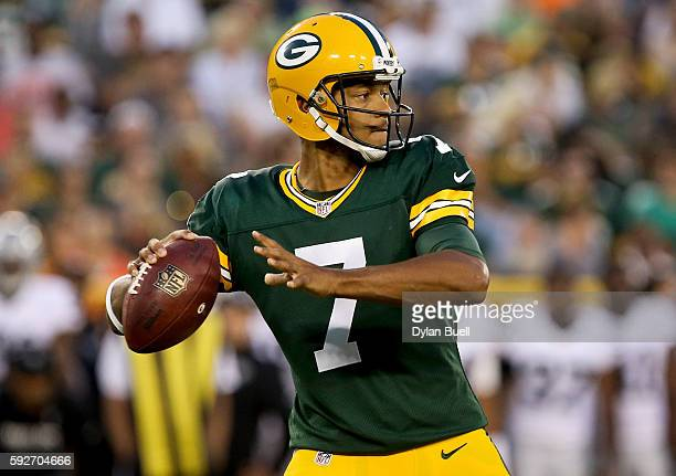 Brett Hundley of the Green Bay Packers drops back to pass in the second quarter of a preseason game against the Oakland Raiders at Lambeau Field on...