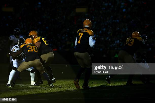 Brett Hundley of the Green Bay Packers drops back to pass in the fourth quarter against the Baltimore Ravens at Lambeau Field on November 19 2017 in...