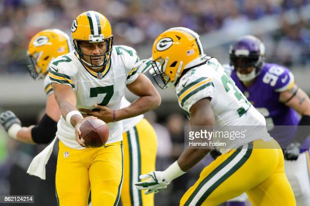Brett Hundley of the Green Bay Packers hands off the ball to teammate Aaron Jones against the Minnesota Vikings during the game on October 15 2017 at...