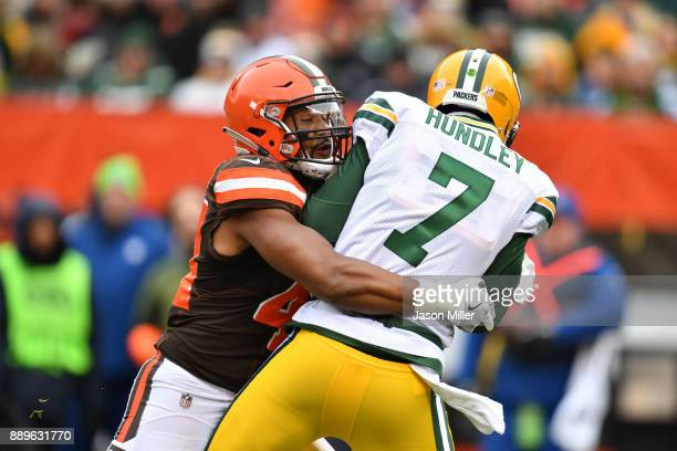 Brett Hundley of the Green Bay Packers is sacked by Nate Orchard of the Cleveland Browns in the second quarter at FirstEnergy Stadium on December 10,...