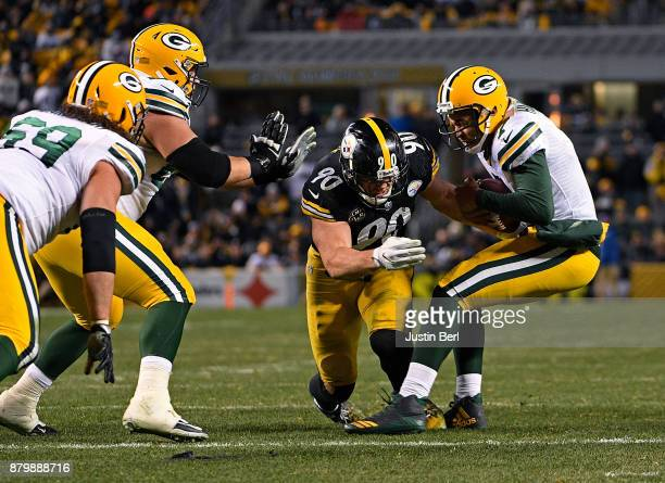 Brett Hundley of the Green Bay Packers is sacked by TJ Watt of the Pittsburgh Steelers in the fourth quarter during the game at Heinz Field on...