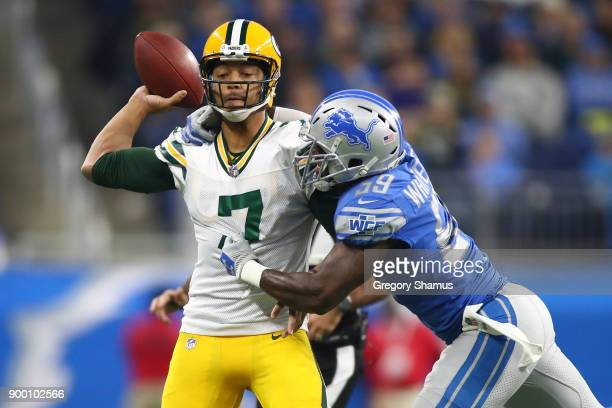 Brett Hundley of the Green Bay Packers is wrapped up by Tahir Whitehead of the Detroit Lions during the first quarter at Ford Field on December 31...