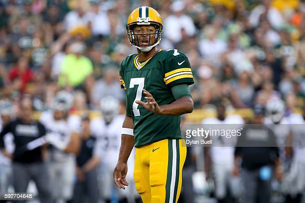 Brett Hundley of the Green Bay Packers plays quarterback in the first quarter of a preseason game against the Oakland Raiders at Lambeau Field on...
