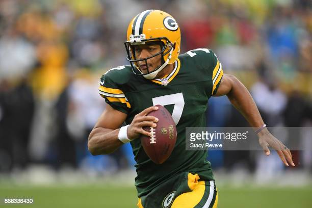 Brett Hundley of the Green Bay Packers runs for yards during a game against the New Orleans Saints at Lambeau Field on October 22 2017 in Green Bay...
