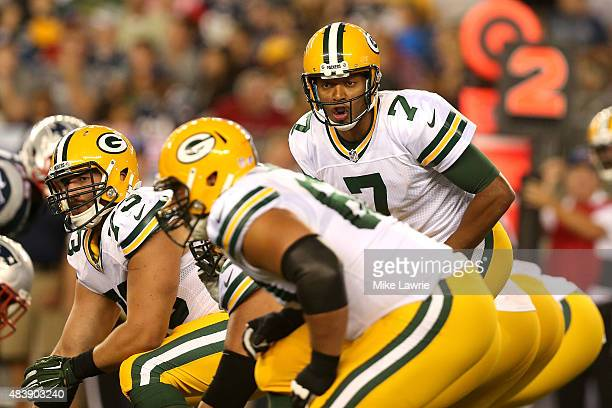 Brett Hundley of the Green Bay Packers speaks at the line of scrimmage in the third quarter against the New England Patriots during a preseason game...