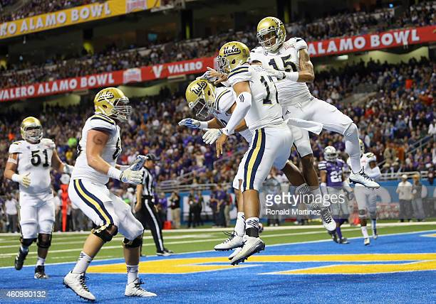 Brett Hundley of the UCLA Bruins celebrates his touchdown against the Kansas State Wildcats in the first quarter during the Valero Alamo Bowl at...