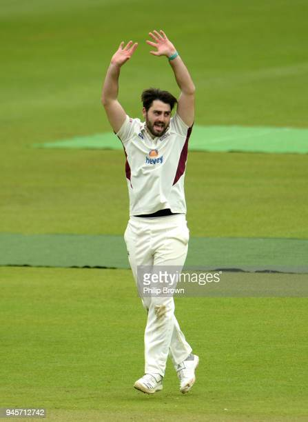 Brett Hutton of Northamptonshire celebrates after dismissing Sam Robson of Middlesex during day one of the Specsavers County Championship Division...