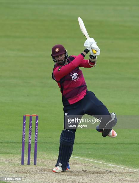 Brett Hutton of Northamptonshire drives the ball for four runs during the tour match between Northamptonshire and Pakistan at The County Ground on...