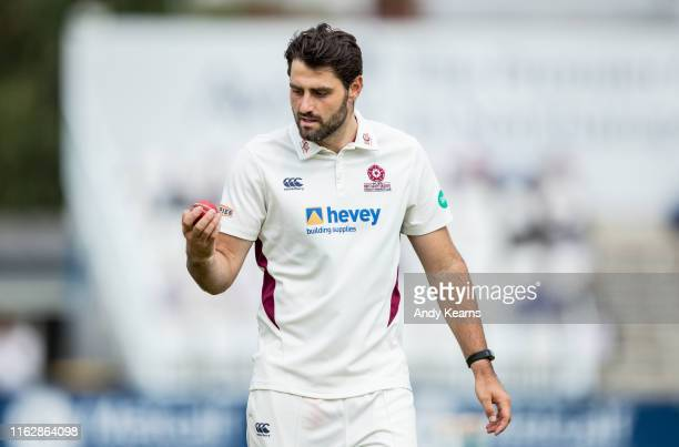 Brett Hutton of Northamptonshire inspecting the ball during the Specsavers County Championship division two match between Northamptonshire and...