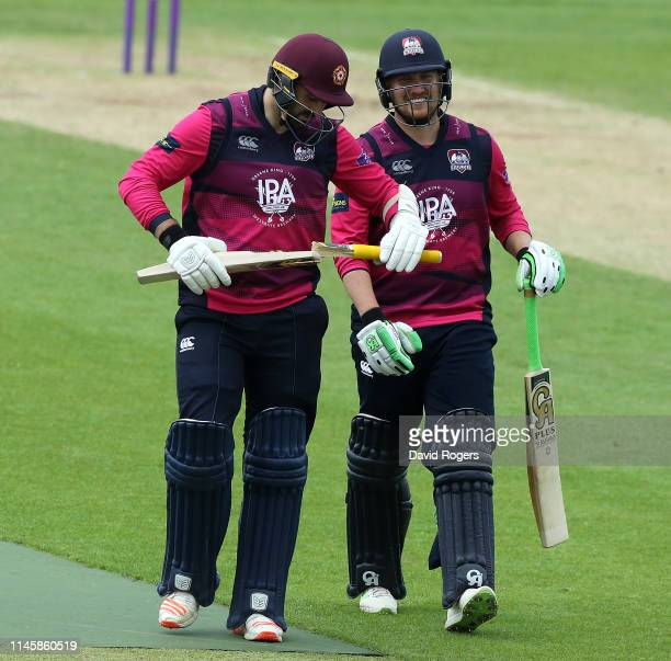 Brett Hutton of Northamptonshire shows his broken bat to team mate Josh Cobb during the tour match between Northamptonshire and Pakistan at The...