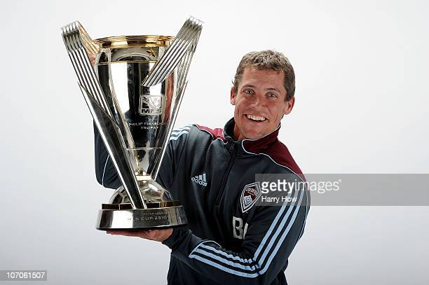 Brett Jacobs Assistant Coach of the Colorado Rapids poses with the Philip F Anschutz MLS Cup trophy following the MLS Cup final at BMO Field on...