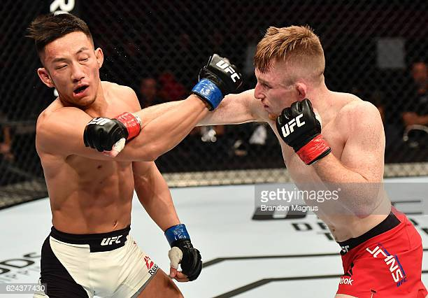 Brett Johns of Wales punches Kwan Ho Kwak of South Korea in their bantamweight bout during the UFC Fight Night at the SSE Arena on November 19 2016...