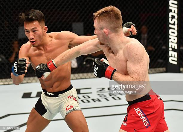Brett Johns of Wales punches Kwan Ho Kwak of South Koreain their bantamweight bout during the UFC Fight Night at the SSE Arena on November 19 2016 in...