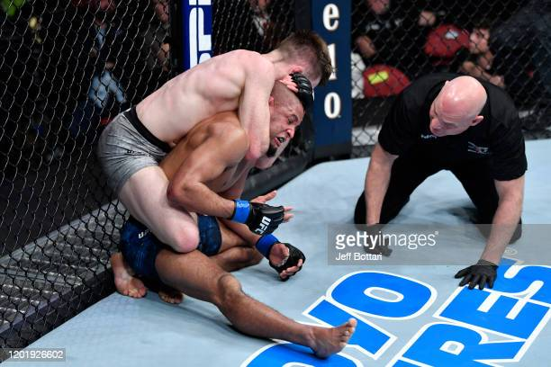 Brett Johns of Wales submits Tony Gravely in their bantamweight bout during the UFC Fight Night event at PNC Arena on January 25 2020 in Raleigh...