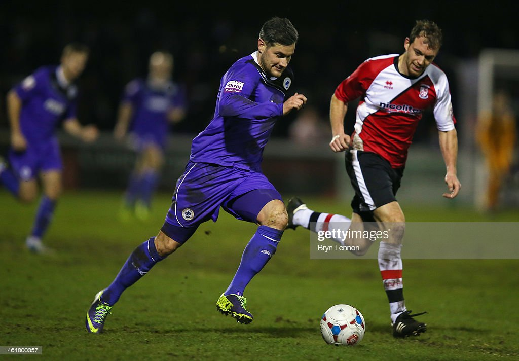Brett Johnson of Woking FC battles with Jamie Reed of Chester City during the Skrill Conference Premier match between Woking and Chester at the Kingfield Stadium on January 21, 2014 in Woking, England.