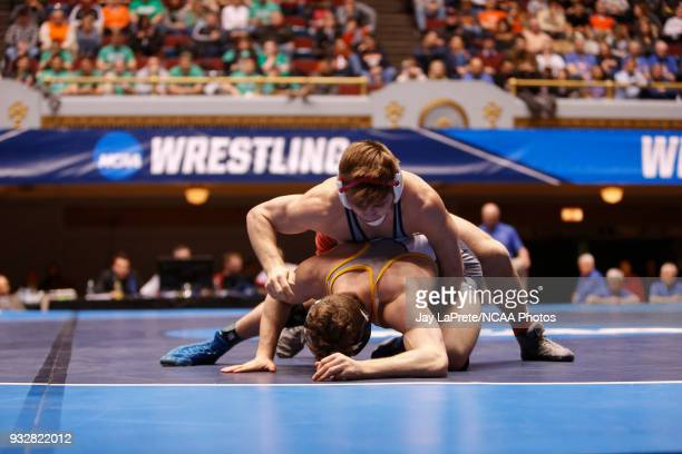 Brett Kaliner of Stevens wrestles Ben Brisman of Ithaca in the 141 weight class during the Division III Men's Wrestling Championship held at the...