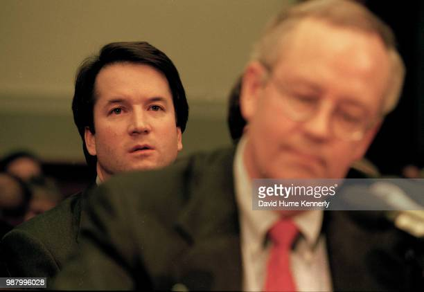 Brett Kavanaugh associate counsel in the Office of Independent Counsel Kenneth Starr sits behind Starr during his testimony before the House...
