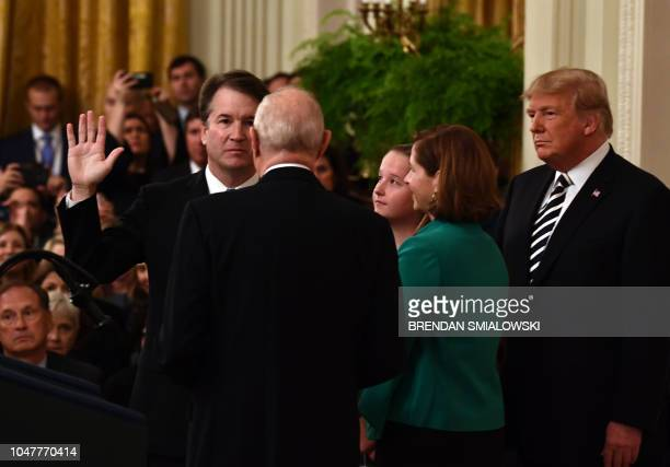 Brett Kavanaugh is swornin as Associate Justice of the US Supreme Court by Associate Justice Anthony Kennedy before wife Ashley Estes Kavanaugh...