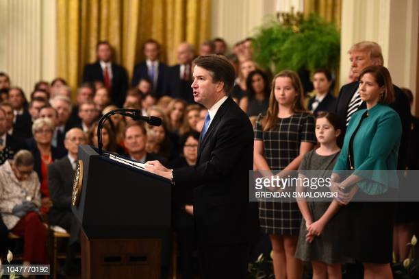 Brett Kavanaugh speaks during his swearingin ceremony as Associate Justice of the US Supreme Court flanked by US President Donald Trump Kavanaugh's...
