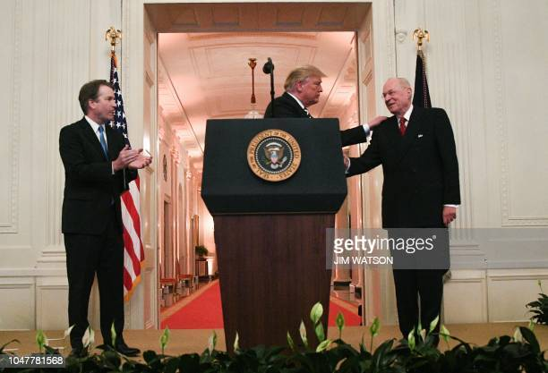 Brett Kavanaugh watches as US president Donald Trump thanks retired Associate Justice Anthony Kennedy during Kavanaugh swearingin as Associate...