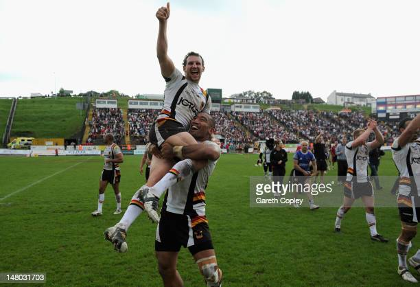 Brett Kearney of Bradford is lifted up by his teammate Manase Manuokafoa after the Stobart Superleague match between Bradford Bulls and London...