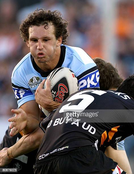 Brett Kearney of the Sharks is tackled during the round seven NRL match between the Cronulla Sharks and the Wests Tigers at Toyota Stadium on April...