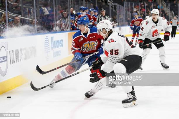 Brett Kemp of the Edmonton Oil Kings battles against Dmitri Zaitsev of the Moose Jaw Warriors at Rogers Place on December 7 2017 in Edmonton Canada