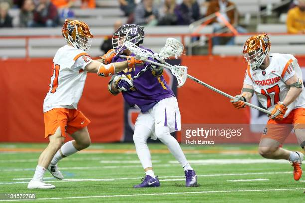 Brett Kennedy and Nick Mellen of the Syracuse Orange check Jakob Patterson of the Albany Great Danes during the second half at the Carrier Dome on...
