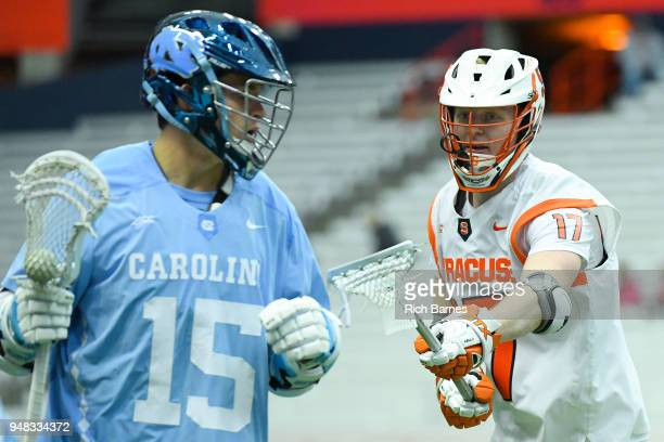 Brett Kennedy of the Syracuse Orange defends Timmy Kelly of the North Carolina Tar Heels during the second half at the Carrier Dome on April 14 2018...