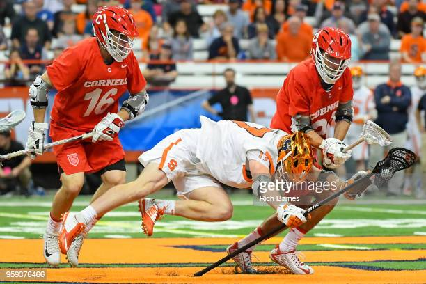 Brett Kennedy of the Syracuse Orange goes airborne while controlling the ball between Jack Bolen and Ryan Bray of the Cornell Big Red during a 2018...