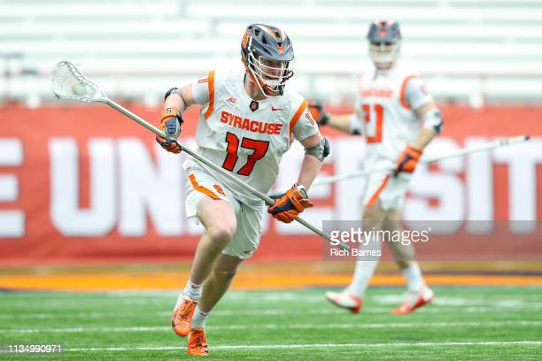 Brett Kennedy of the Syracuse Orange runs with the ball against the Johns Hopkins Blue Jays during the second half at the Carrier Dome on March 9...