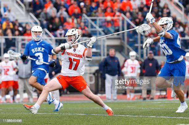 Brett Kennedy of the Syracuse Orange shoots the ball in front of Garrett Leadmon of the Duke Blue Devils during the first half at Michael J Bragman...
